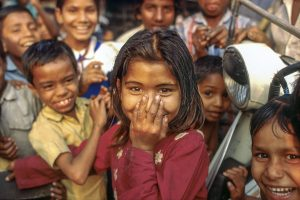 Bangladesh-Dhaka, Life in the slums. Group of children and shy little girl.