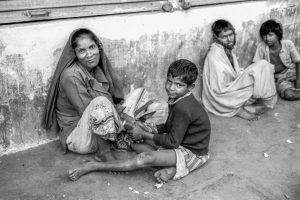 Bangladesh-Dhaka, Life in the slums. Mother and sun living in the street.