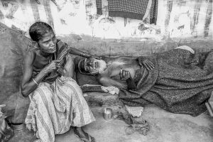 Bangladesh-Dhaka, Life in the slums. Woman and her dying husband.