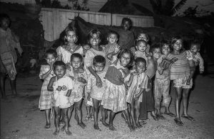 Bangladesh-Dhaka, Life in the slums. Middle of the night portrait of group children.
